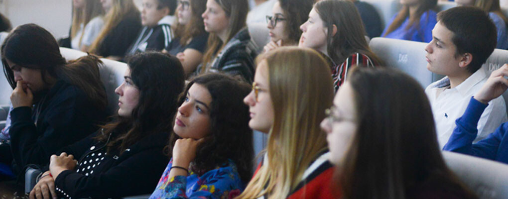 Young people in museum auditorium