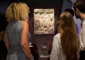 Young visitors viewing ancient object in museum