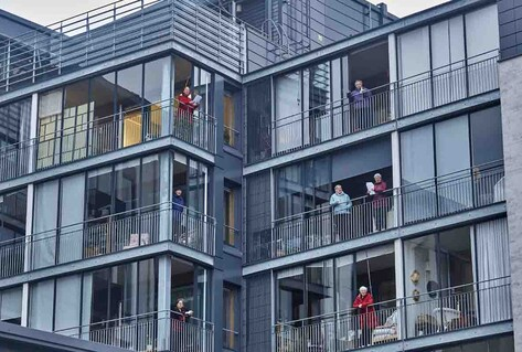 Elderly citizens on balconies singing