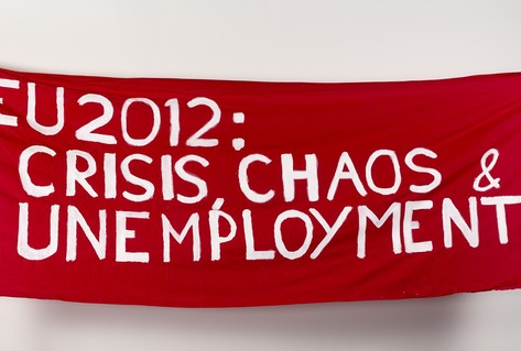 Red white banner protesting EU unemployment