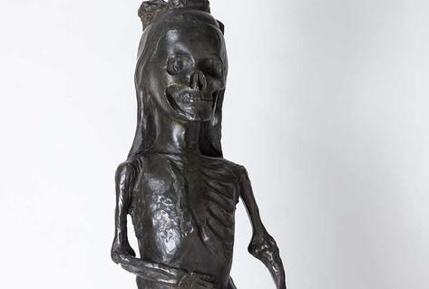 Bronze sculpture skelton in dress