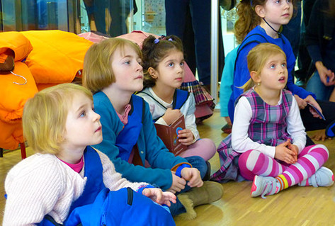 Girls listening to facilitator in Family Discovery Space