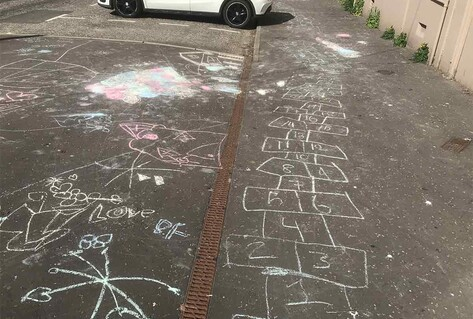 children's chalk drawings on ground for playing