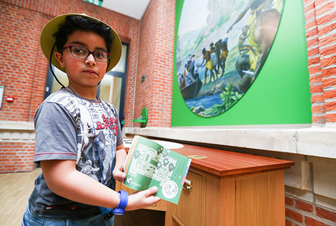 Young visitor showing learning material