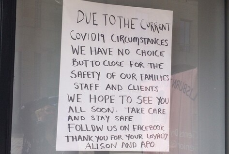 Closed sign on door of Turkish barbers