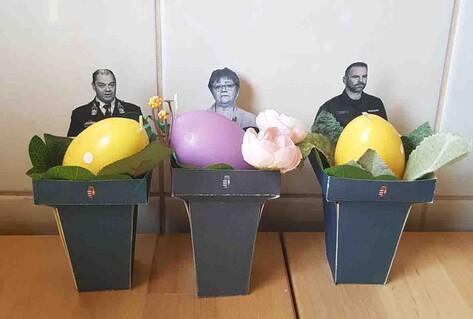 three cardboard eg holders with photos