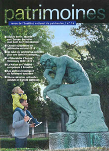 Cover image man holding child on shoulders looking at statue