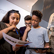 Young people looking at museum resources