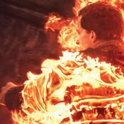 Man on fire walking