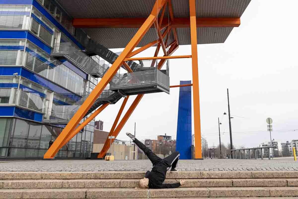 Breakdancer posing in construction site