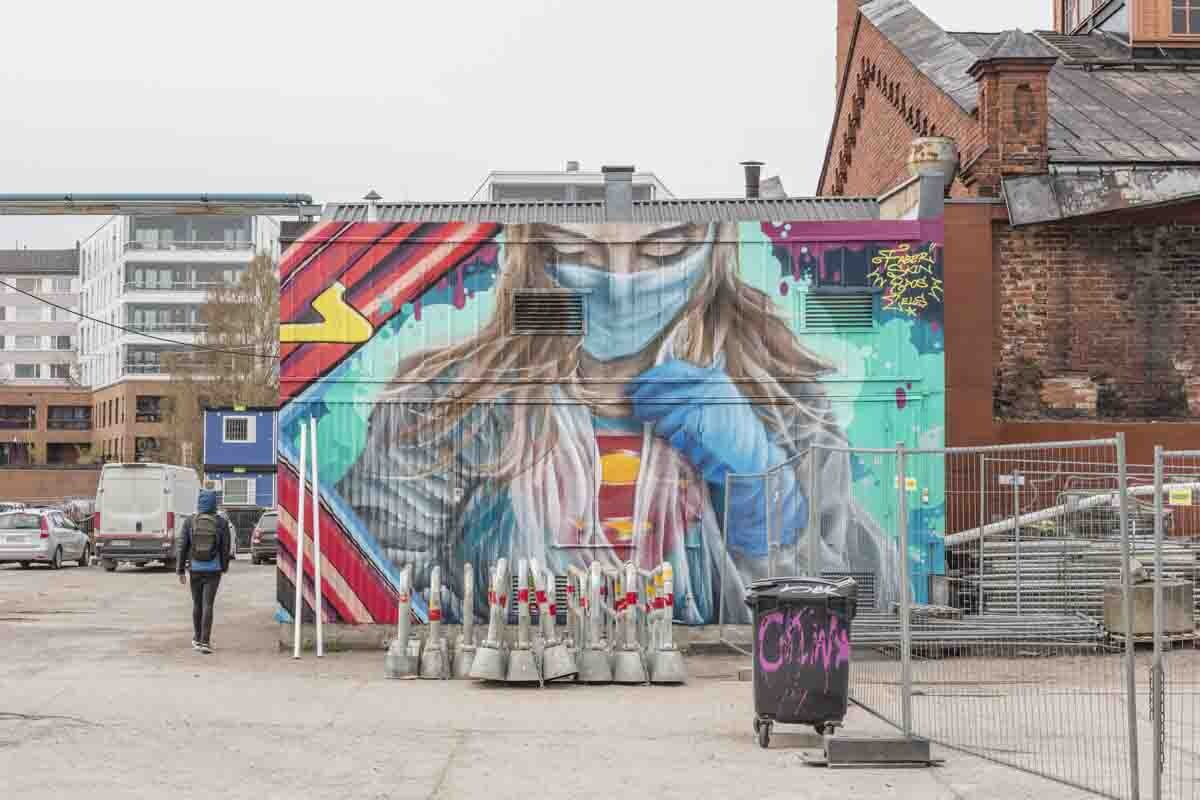 Colourful mural of super-nurse in mask