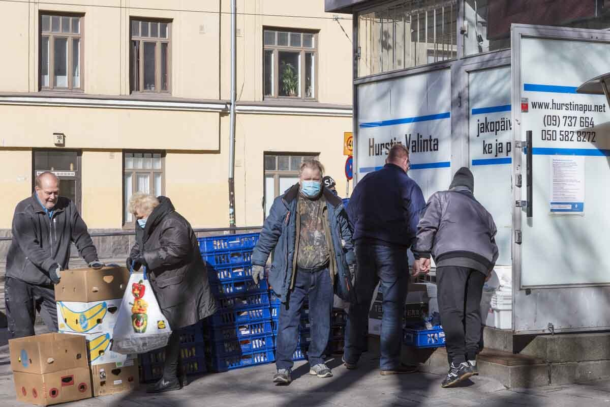 Disadvantaged people collecting food from truck