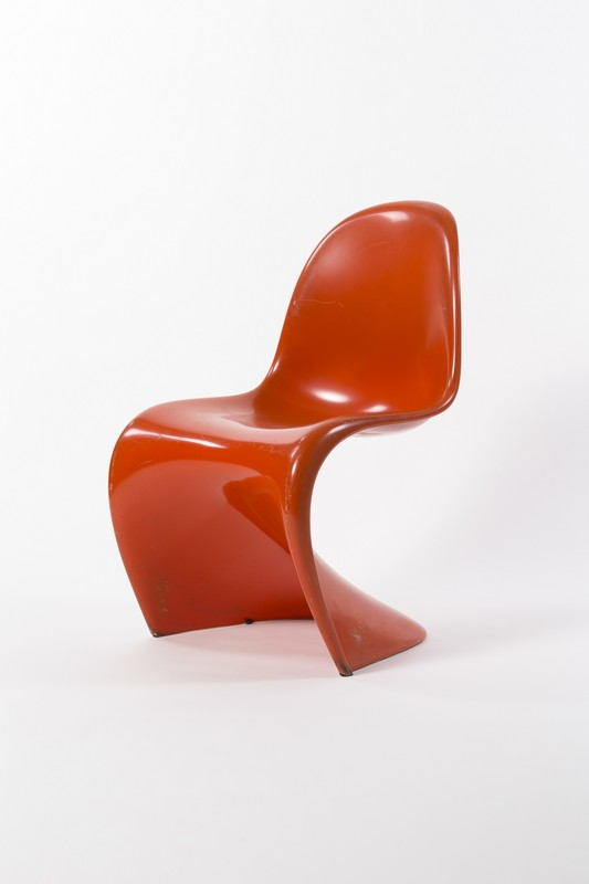 Red plastic S-shaped chair