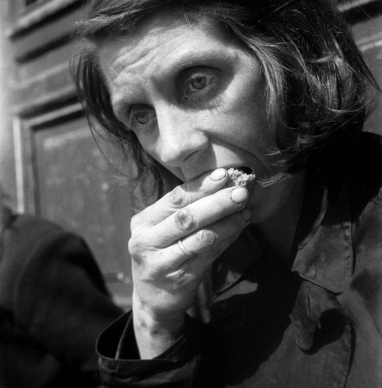 Black white photograph starving woman eating