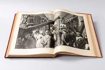 Image from exhibition catalogue, men viewing new military weapons