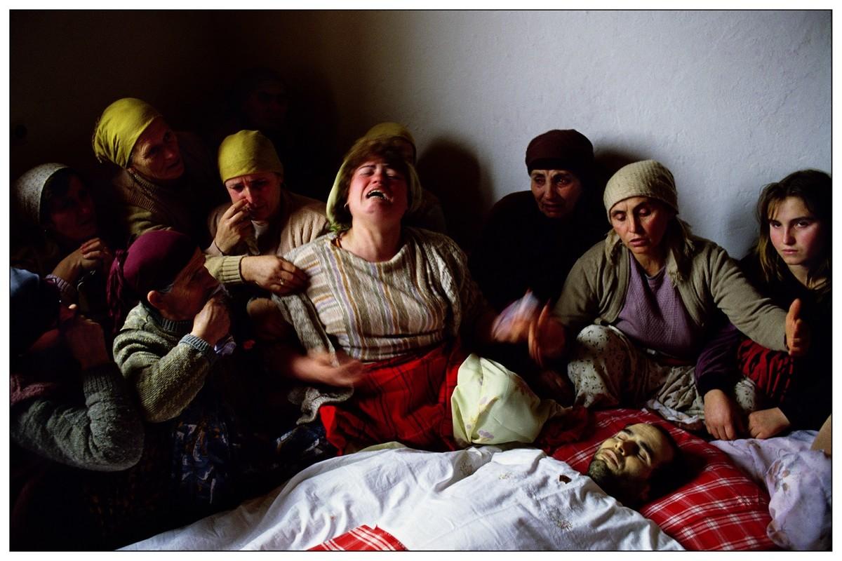 Woman crying Kosovo funeral