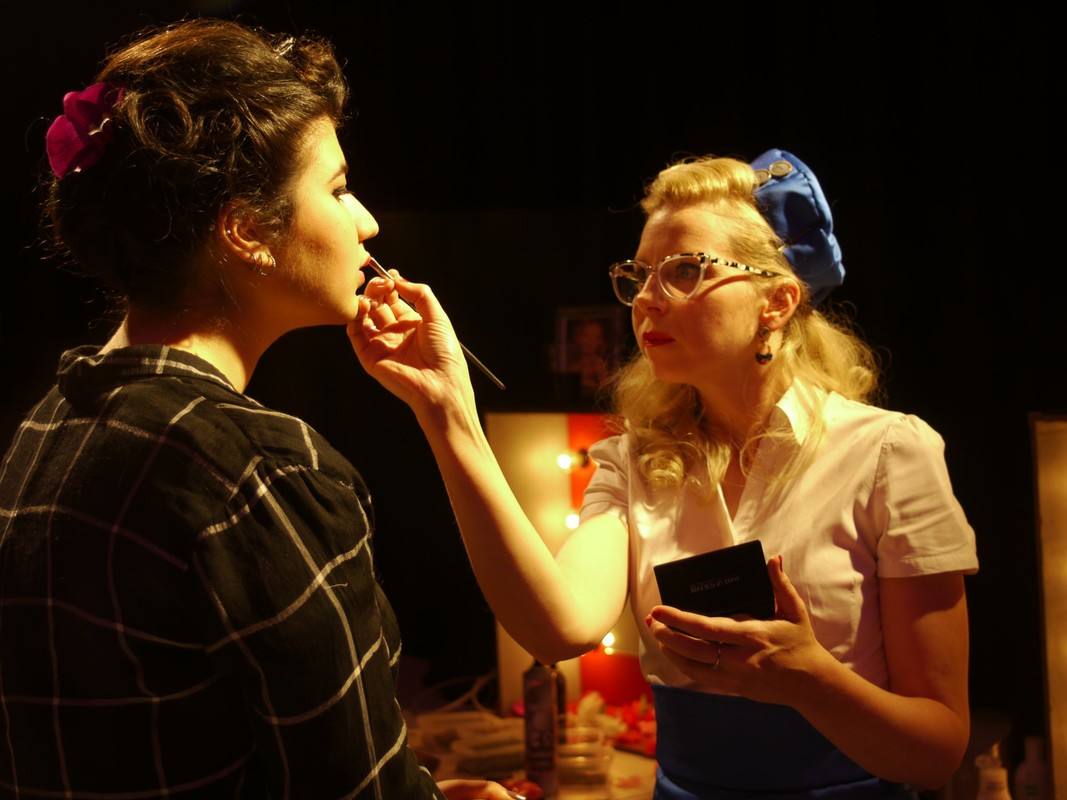 Blonde woman in retro clothes giving make up
