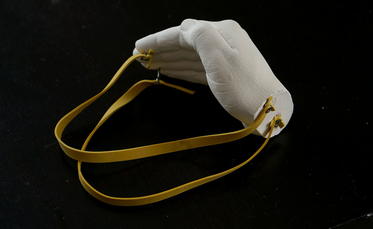 Anna Vasof, Hand Mask, 2020, stone-hard, weatherproof ceramic and elastic bands. Collection of the House of European History