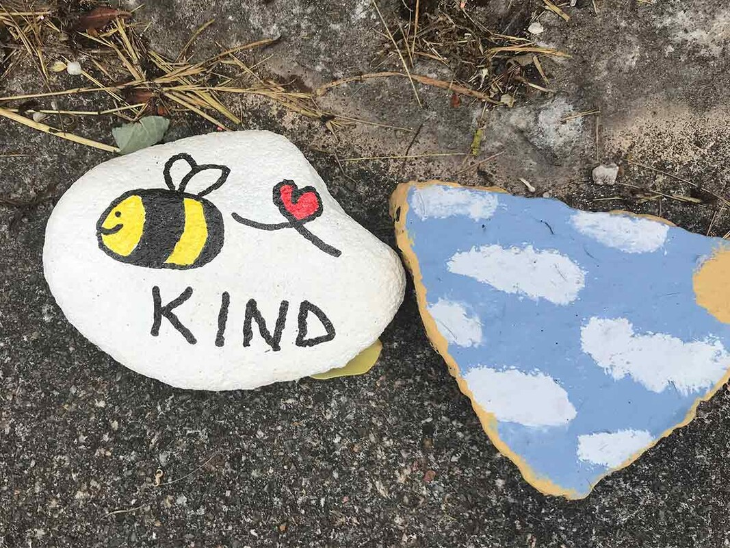 painted pebbles with kindness message