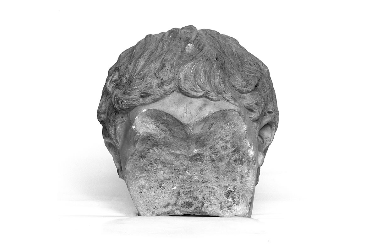 Marble head of the Emperor Geta vandalised with a chisel following the act of damnatio memoraie