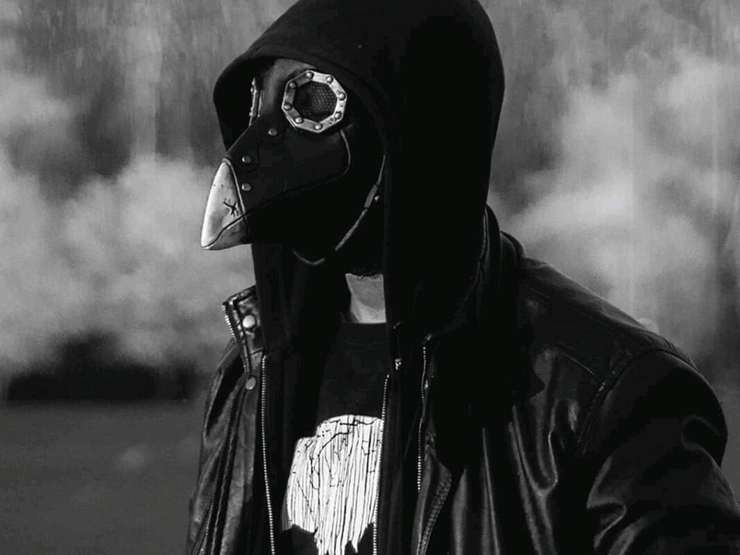 Black and white photo of bird mask
